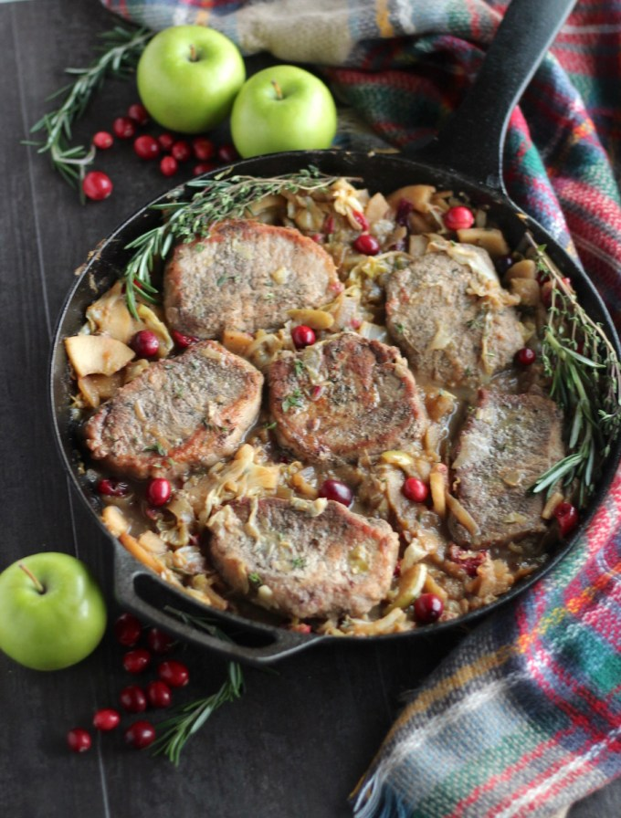 Apple Cranberry Skillet Pork Chops (AIP, Paleo) - a rustic, festive main dish for the holidays, featuring pork, apples, cranberries, and cabbage! | fedandfulfilled.com
