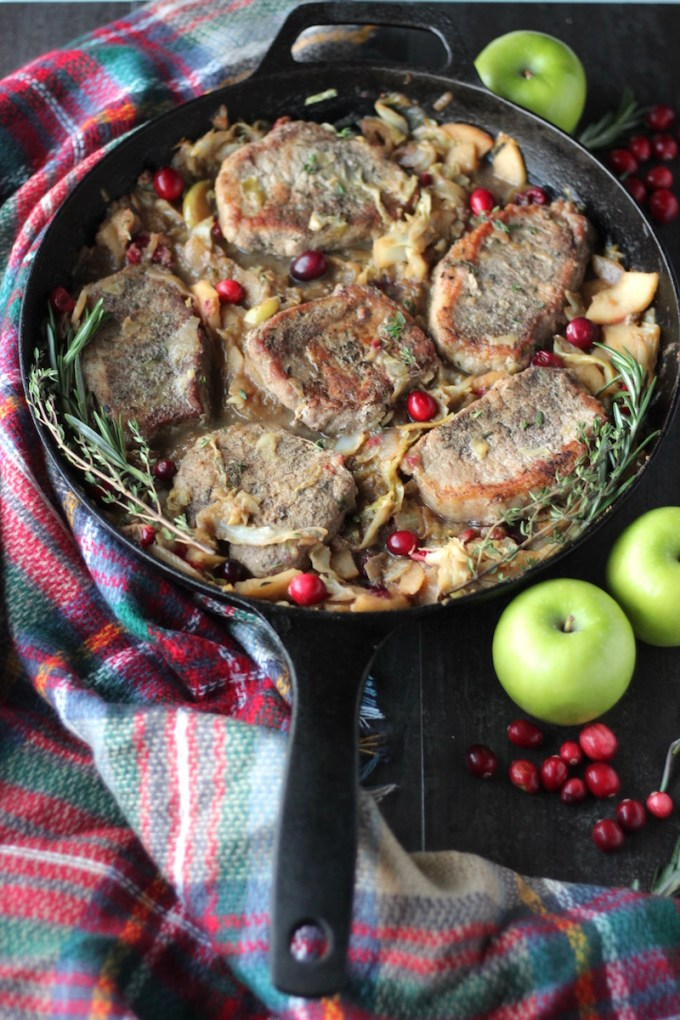 Apple Cranberry Skillet Pork Chops (AIP, Paleo) - juicy pork, sauteed apples, cranberries, cabbage, and onions come together for an easy and tasty main course! | fedandfulfilled.com
