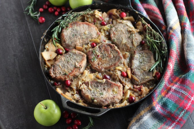 Apple Cranberry Skillet Pork Chops (AIP, Paleo) - a festive holiday pork dish featuring cranberries, apples, cabbage, onions, and fresh herbs! Simple and delicious! | fedandfulfilled.com