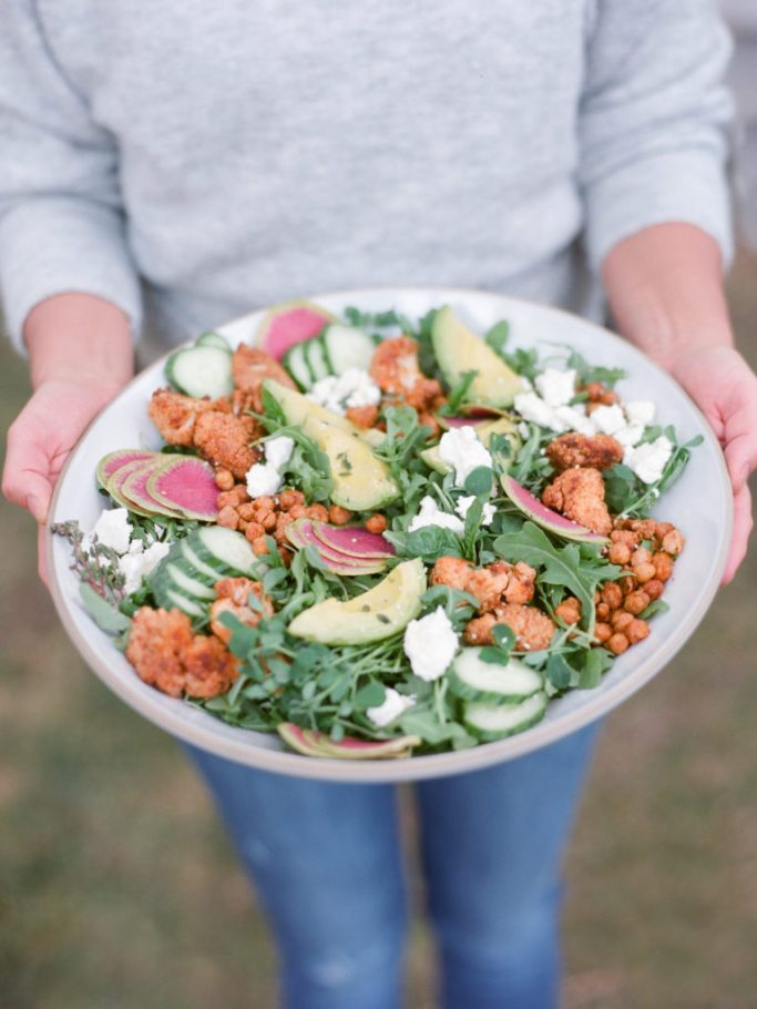 Chef Amy Lynne Power holding salad