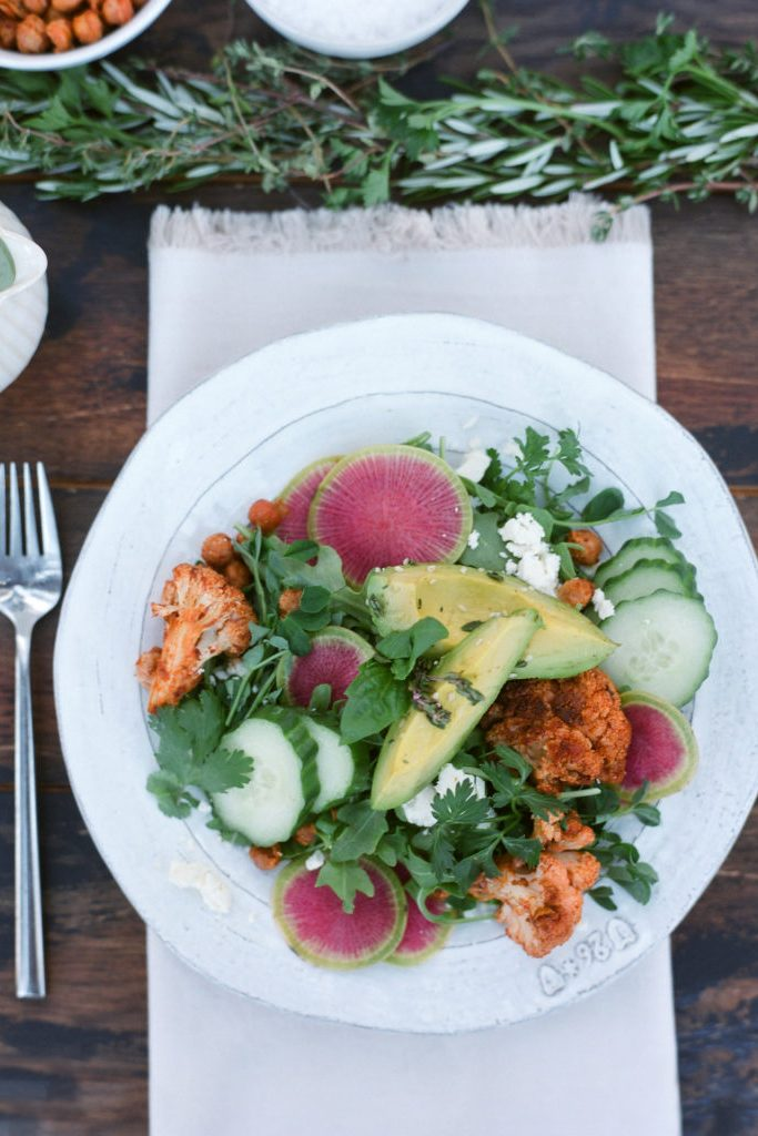 Roasted cauliflower and chipotle chickpea salad on a table setting
