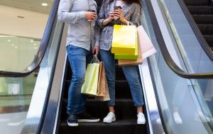 Couple having after shopping coffee in mall, crop