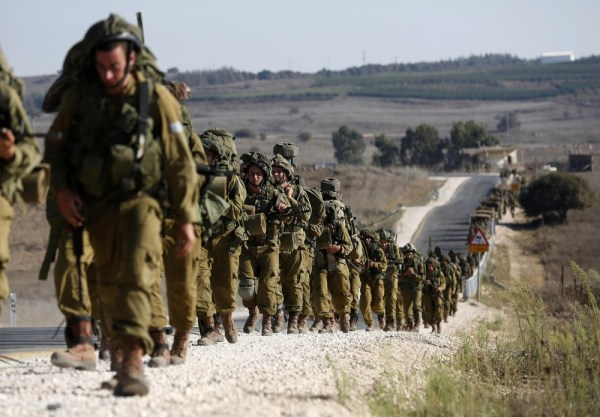Image: Israeli soldiers from the paratroopers brigade take part in a drill in the Israeli-occupied Golan Heights, near the border with Syria