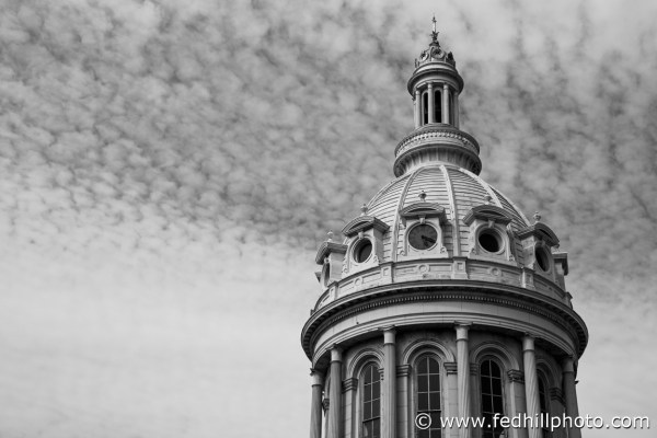 Black and white fine art photo of City Hall Dome in Baltimore, Maryland. Puffy clouds.