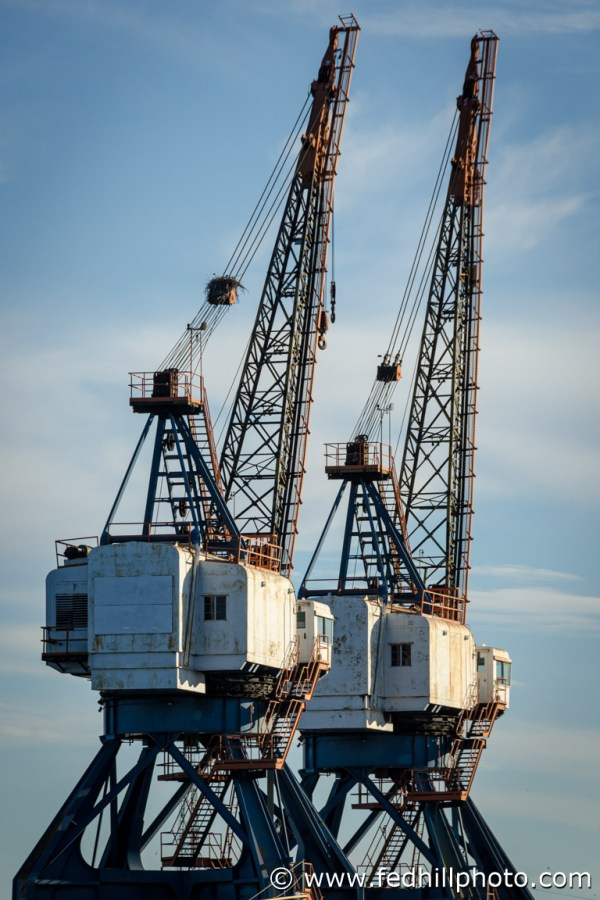 Fine art photo of industrial ship cranes in Locust Point, Baltimore, Maryland.