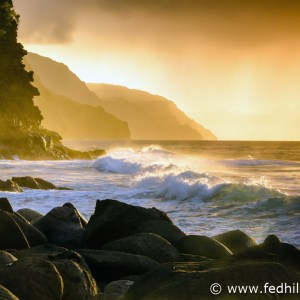 Fine art photograph of sunset over Pacific Ocean surf, water, and waves at Napali Coast Ke'e beach and cliffs, Kauai, Hawaii.