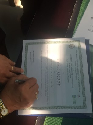 Scholarship Certificate awarded to FEED's DMMMSU Scholar Renalyn M. Canillo