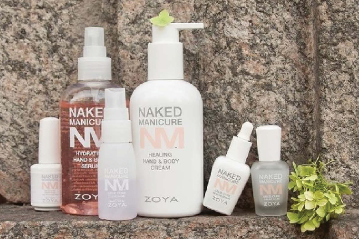 ZOYA Naked Manicure's Hydrate & Heal System, Rescue Repair, Naked Gelie and Clear-Shine Spray are displayed on a marble background.