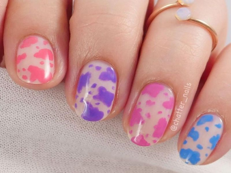 A cow print mani using the ZOYA Dreamin' collection by @chatter_nails.