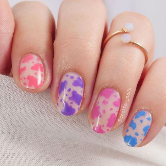A cow print manicure using the ZOYA Dreamin' collection by @chatter_nails.