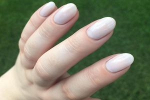 A manicure with Sabrina by ZOYA painted on the nails.