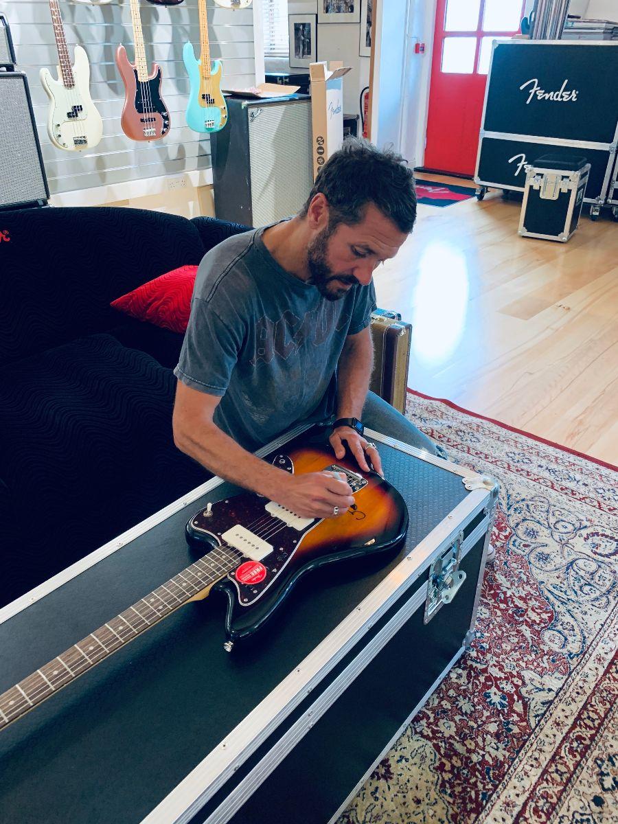 Grant signing prize guitar