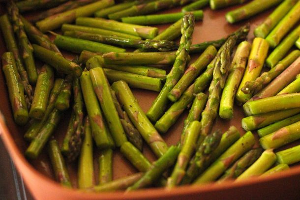 sauteed asparagus with lemon in a pan