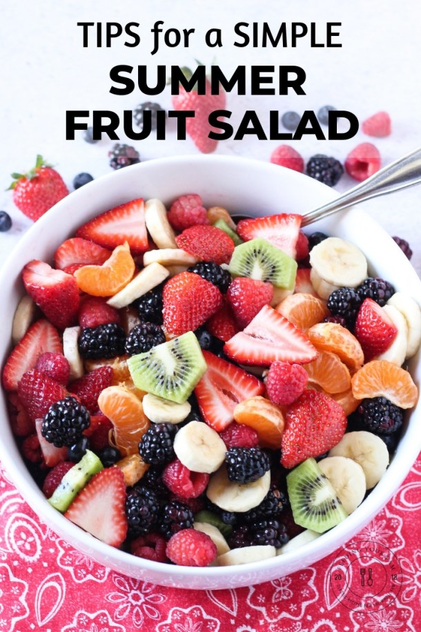 """Big bowl of mixed berry fruit salad with the words """"Tips for a simple summer fruit salad"""""""