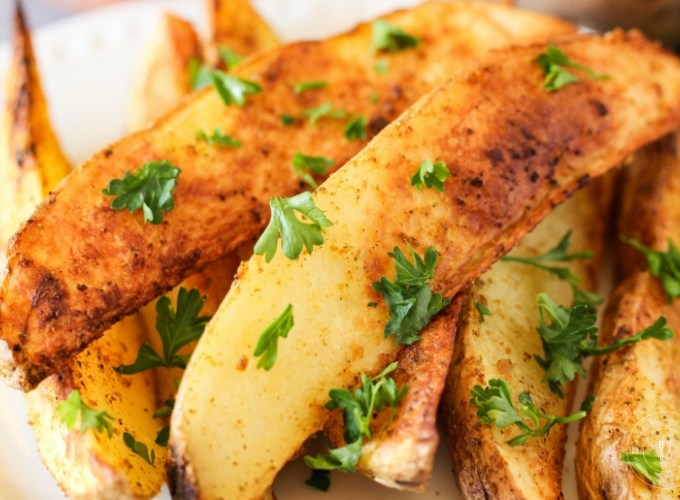 golden air fried potato wedges topped with parsley
