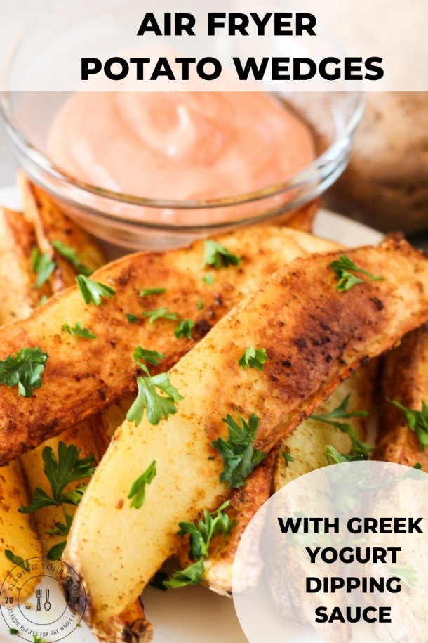 air fryer potato wedges on a plate with greek yogurt dipping sauce