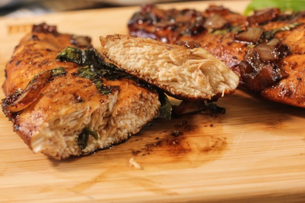 sliced chicken on a wooden cutting board