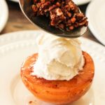 topping caramelized peaches with toasted pecans