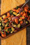 oven roasted vegetables on a wooden platter