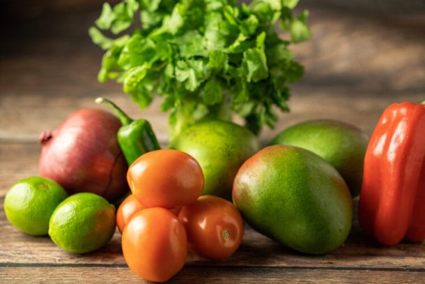 tomato, mango, red pepper, red onion, limes and cilantro. Ingredients for mango salsa