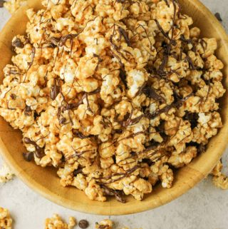 bowl of peanut butter popcorn with chocolate drizzle