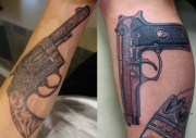 awesome gun tattoo design