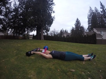 lay flat with hands overhead