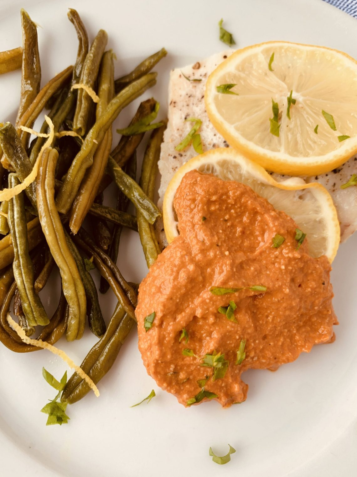 This shows how to serve romesco sauce with baked fish.