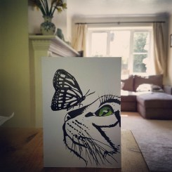 Handrawn picture of a cat and butterfly