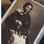 black and white photo of sculptor Mary Edmona Lewis sitting down wearing a dark coloured shawl