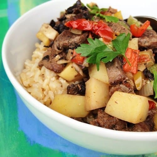 This recipe for Spicy Beef and Potato Stir-fry Over Brown Rice is super comforting and appetizing with a spicy flavor that's ready in half hour