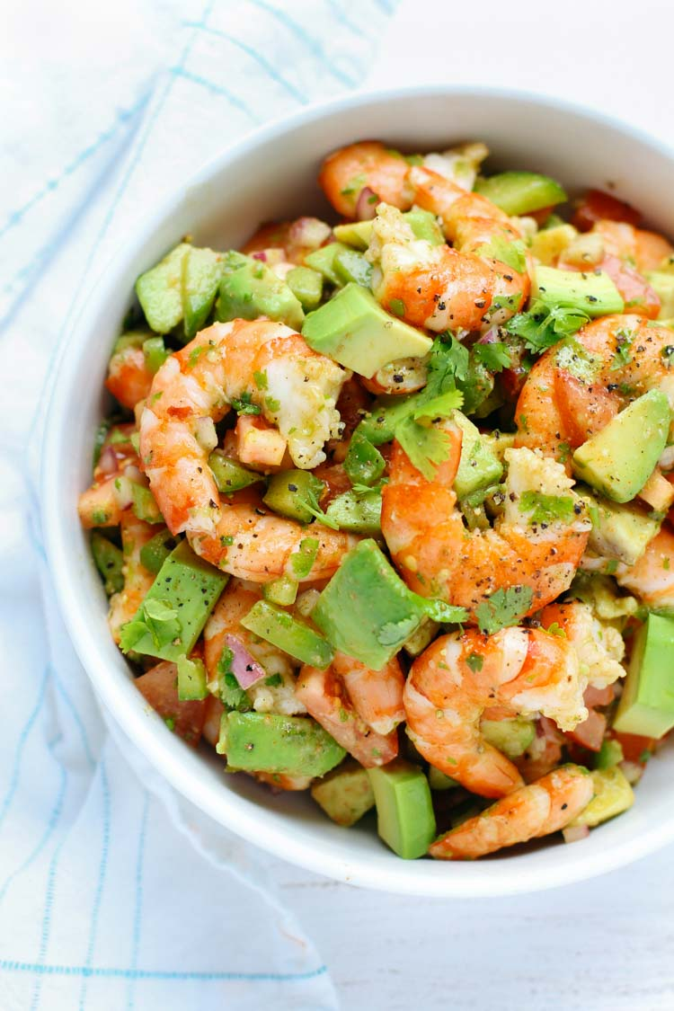 This light and simple Shrimp Avocado Summer Salad uses only a few simple ingredients with a zesty lime olive oil dressing that adds a burst of fresh flavor!