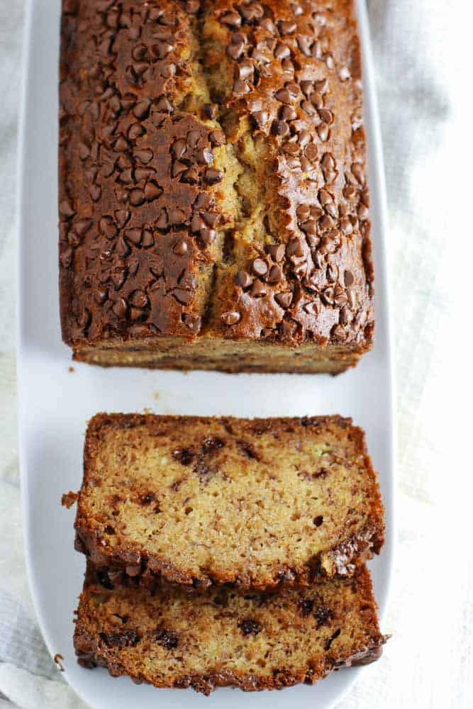 This Whole Wheat Chocolate Chip Banana Bread is a healthy easy recipe that you can easily whip together for breakfast or dessert with simple ingredients!