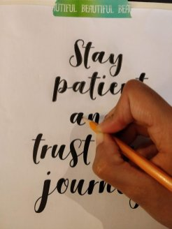 Transfer quote onto canvas by outlining the letters