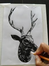 Transfer design onto canvas by outlining the deer
