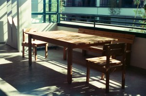 A sunlit table on a balcony