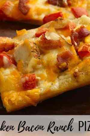 How to make the best chicken bacon ranch pizza recipe - This semi homemade pizza is quick and easy with a white ranch sauce and made with Pillsbury crescent rolls as a crust! Perfect comfort food and great for quick dinners!