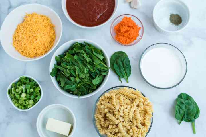 Creamy pasta with spinach and red sauce ingredients