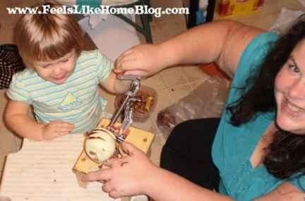 A little girl peeling an apple