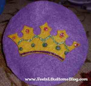 A felt Jesse tree ornament with a crown