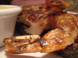 A close up of a plate of food, with Shrimp and butter