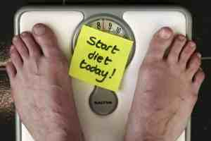 A scale that says Start Diet Today!
