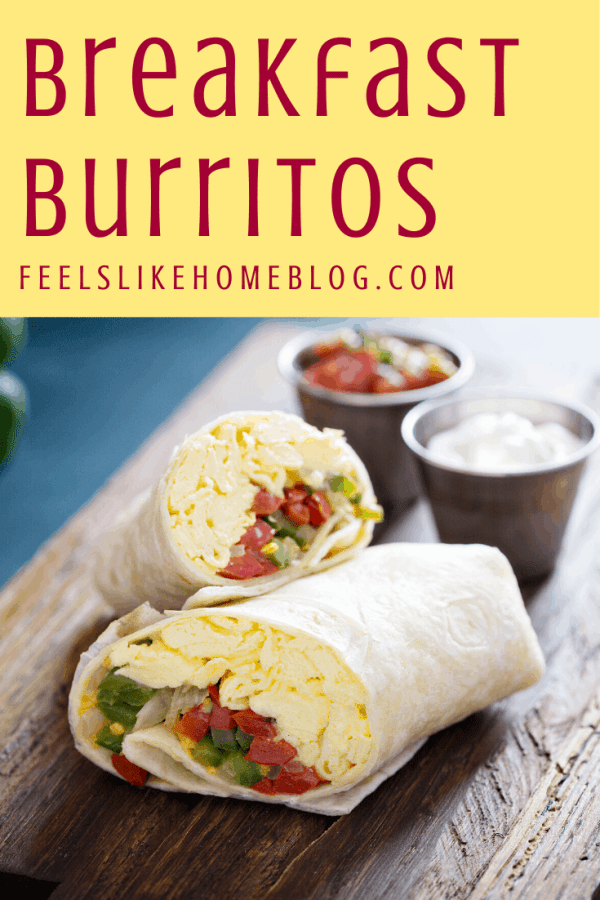 A breakfast burrito sitting on top of a wooden table