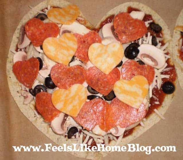 A tortilla pizza shaped like a heart