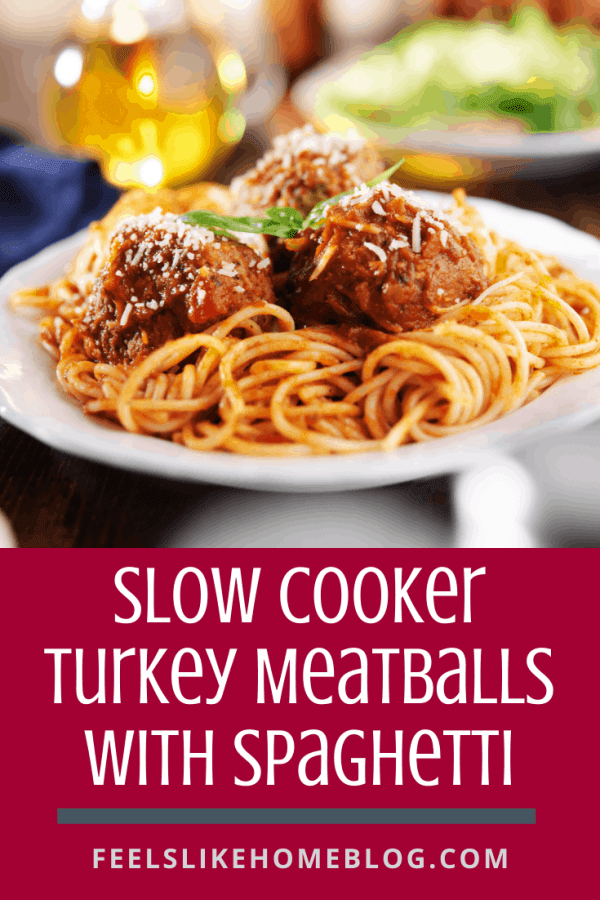 A plate of food on a table, with Spaghetti and Meatballs