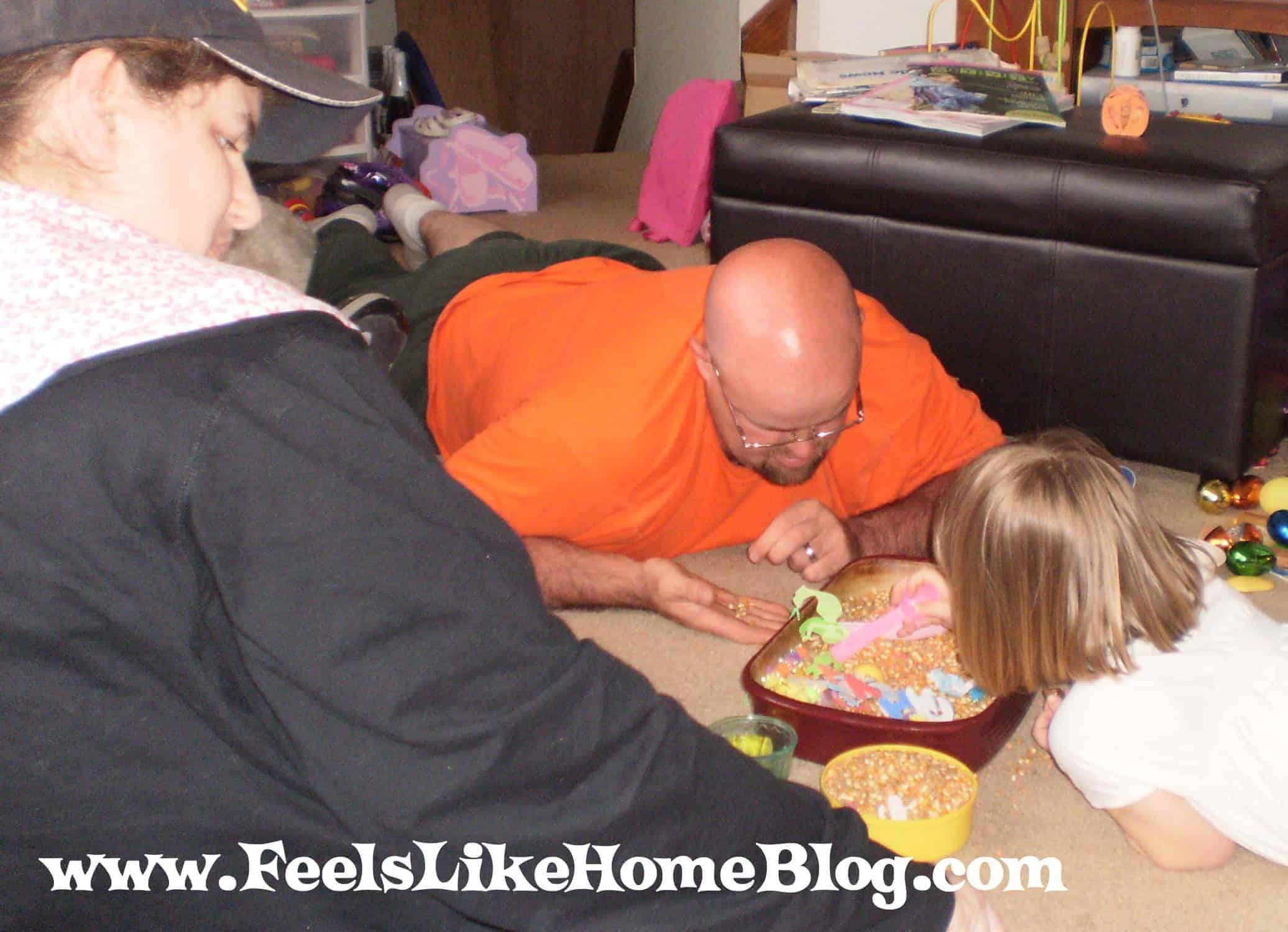 picking popcorn out of sensory tub