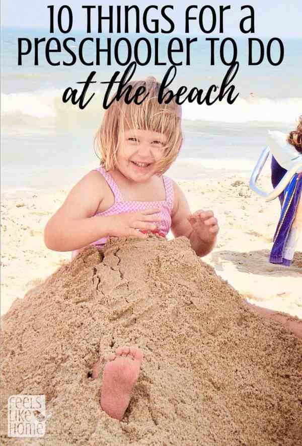 A little girl that is sitting in the sand