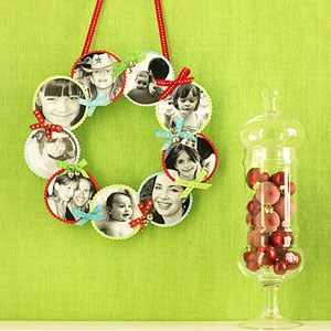 A photo wreath hanging on the wall
