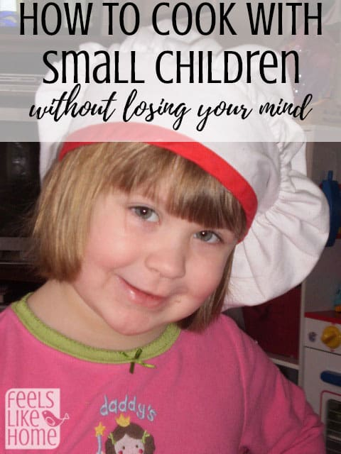 A little girl wearing a chef\'s hat