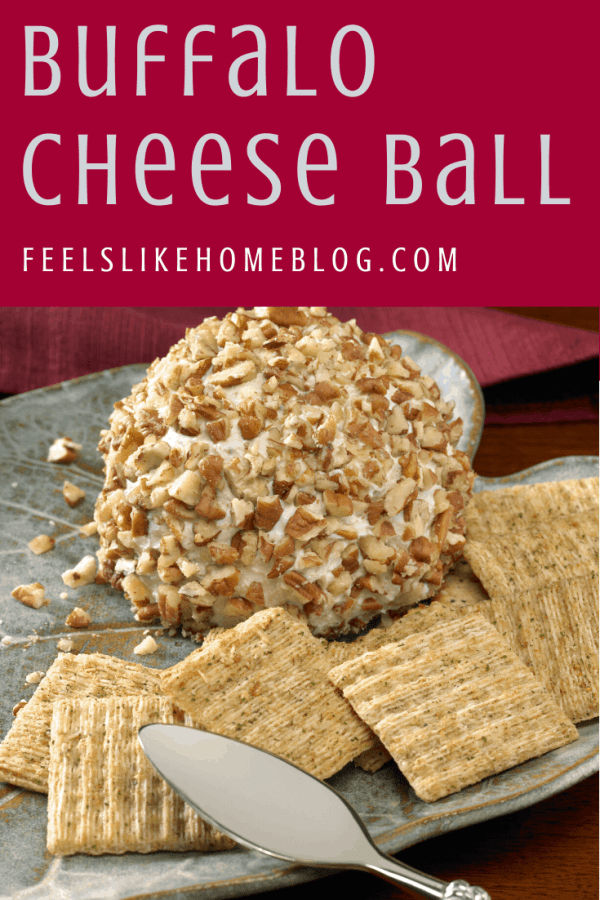 A cheeseball on a plate with crackers